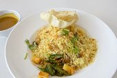 image of nasi  - Indian Nasi Briyani Rice Dish with Curry Sauce Pickled Vegetable and Crackers Local Dish - JPG