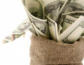 picture of bundle money  - Canvas money sack with one hundred dollar bills - JPG