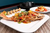 picture of red snapper  - Freshly prepared Thai style whole fish red snapper dinner with sweet and sour shrimp and pan fried gyoza dumplings appetizer - JPG