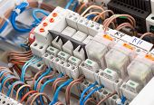 stock photo of fuse-box  - Closeup of electrical supplies in switchgear cabinet - JPG