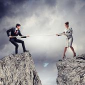foto of rope pulling  - Confrontation between two business people - JPG