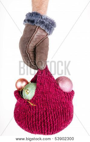Hand Holding A Knitted Hat With Christmas Decorations