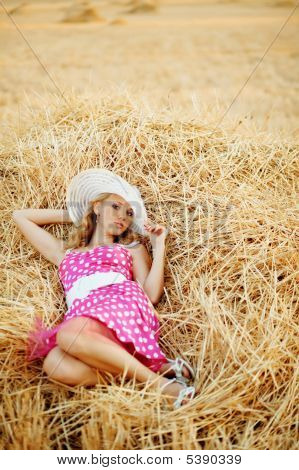 Pin-up Girl Resting In Haystack