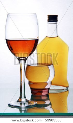 Bottle And Glasses With Alcohol.