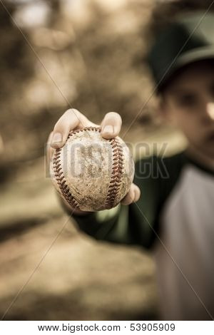 Young boy holding a baseball