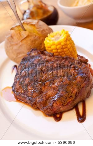 Sirloin Strip Steak With Corn Cob Vegetables And Savory Sauce