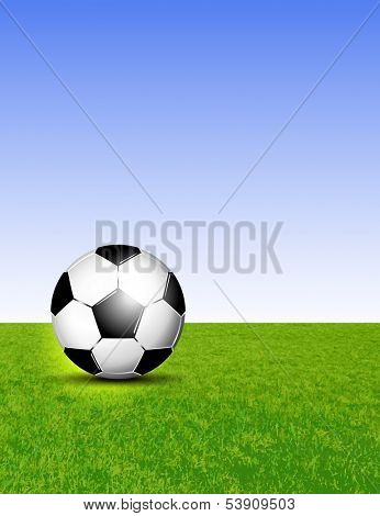 Soccer ball on grass against blue sky