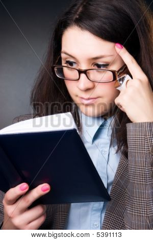 Young Businesswoman Reading A Book