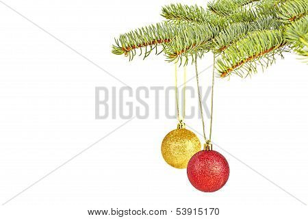 Christmas Decoration. Red And Yellow  Balls On White Background. Selective Focus