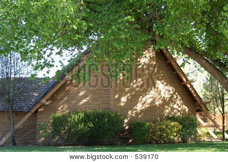 Triangular Stone/brick Church With Cross