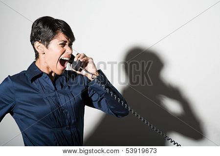 Businesswoman shouting on telephone