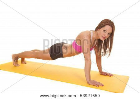 Woman wearing Pink Bra on Fitness Mat