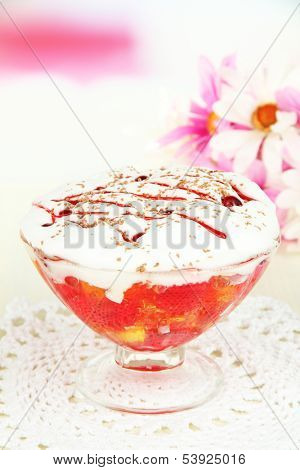 Tasty jelly in bowl on table on light background