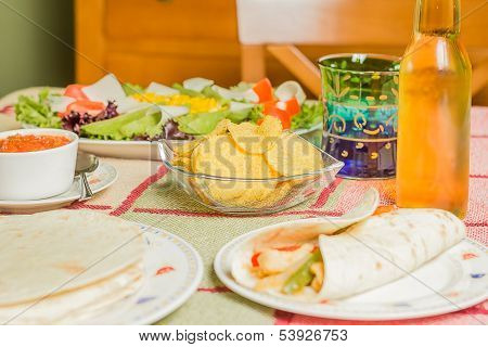 Traditional mexican food with a bowl of nachos