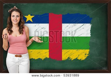 Beautiful And Smiling Woman Showing Flag Of Central African Republic On Blackboard
