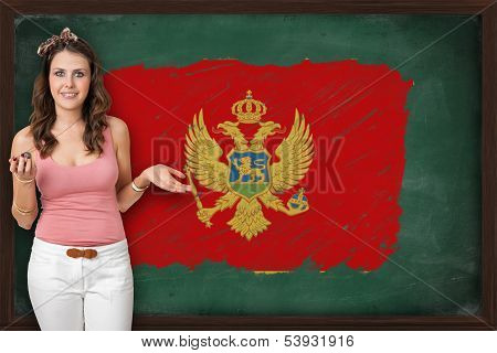 Beautiful And Smiling Woman Showing Flag Of Montenegro On Blackboard