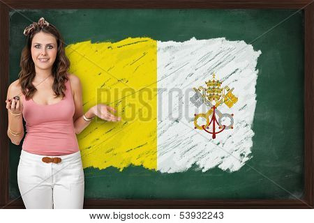 Beautiful And Smiling Woman Showing Flag Of Vatican City On Blackboard
