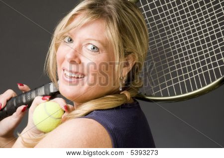 Woman Practicing Tennis Stroke