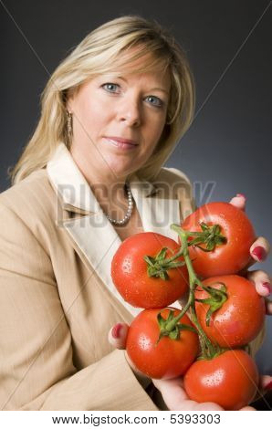 Woman With Bunch Of Fresh Ripe Tomatoes