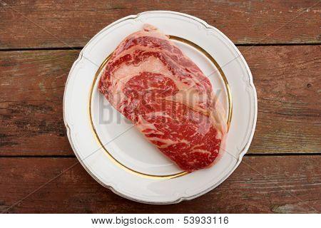 Premium quality kobe beef ribeye steak in plate on wooden table