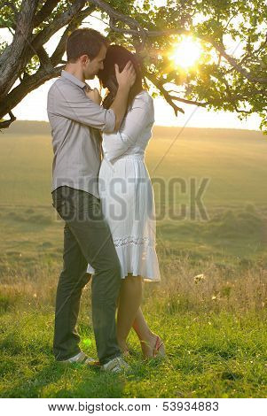 Couple sweethearts under tree