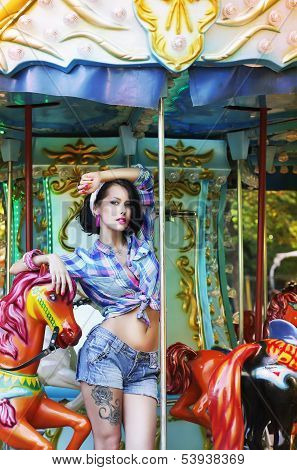 Merry-go-round. Playful Stylish Showy Woman In Roundabout. Funfair