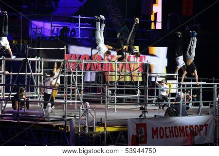 MOSCOW - MAR 02: Power exercises on the horizontal bar on the festival extreme sports Breakthrough 2013 in the arena of the Olympic Sports Complex, on March 02, 2013 in Moscow, Russia.