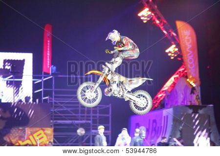 MOSCOW - MAR 02: Jump on a motorcycle with acrobatic stunts on the festival extreme sports Breakthrough 2013, on March 02, 2013 in Moscow, Russia.