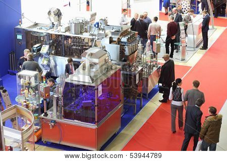 MOSCOW - MAR 12: The models of industrial machinery at the 12th International Exhibition Dairy and Meat Industry on March 12, 2013 in Moscow, Russia.