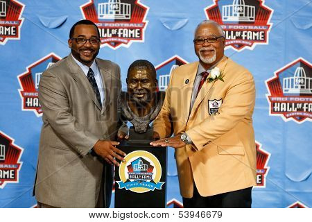 CANTON, OH-AUG 3: Chad Culp (L) and his father Curley Culp pose with his Hall of Fame bust during the NFL Class of 2013 Enshrinement Ceremony at Fawcett Stadium on August 3, 2013 in Canton, Ohio.