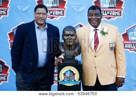 CANTON, OH-AUG 3:  David Robinson (L) poses with his father Dave Robinson with his bust during the NFL Class of 2013 Enshrinement Ceremony at Fawcett Stadium on August 3, 2013 in Canton, Ohio.