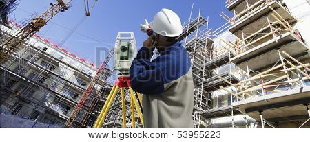 surveyors measuring instrument inside building site, panoramic view