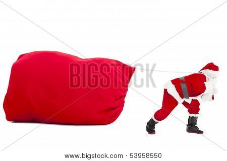 Santa Claus Carrying A Heavy Gift Sack