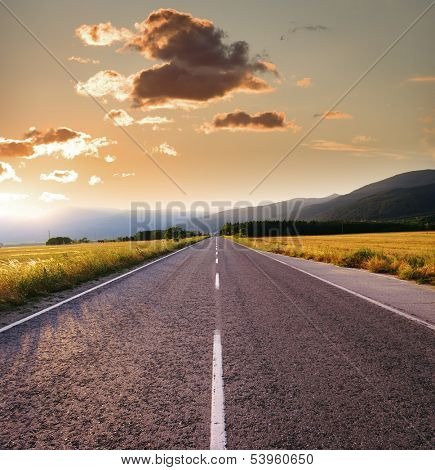 straight road at the sunset