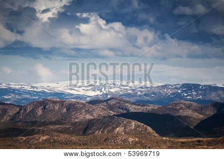 Norwegian Mountain Landscape With Dramatic Cloudy Sky