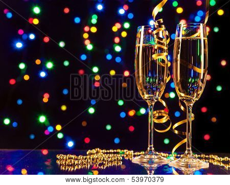 Glasses of wine with blur light spots on background