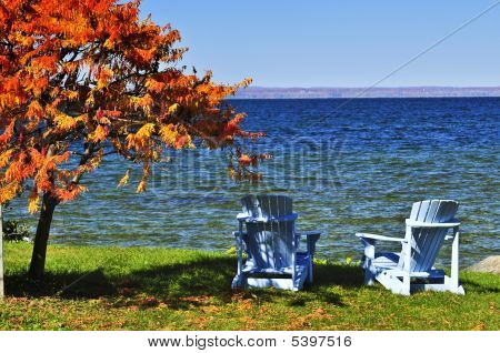 Wooden Chairs On Autumn Lake