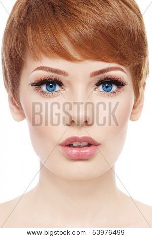 Portrait of young beautiful woman with stylish short haircut and fresh make-up over white background