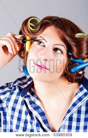 beautiful woman applying make up