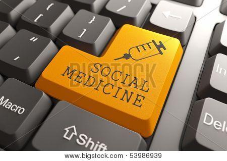 Keyboard with Social Medicine Orange Button.