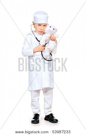 Full length portrait of a little boy playing a doctor veterinarian. Different occupations. Isolated over white.