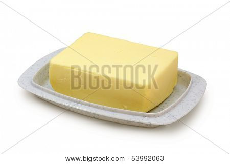 Butter on grey butterdish isolated on white background