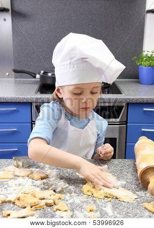 Little girl baking cakes