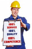 Construction worker making advertising with clipboard for 100% service 100% quality and 100% compete