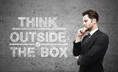 picture of thinking outside box  - businessman thinking and think outside the box - JPG