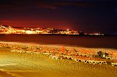 a view of Playa del Ingles beach at night in Maspalomas, Gran Canaria, Canary Islands, Spain