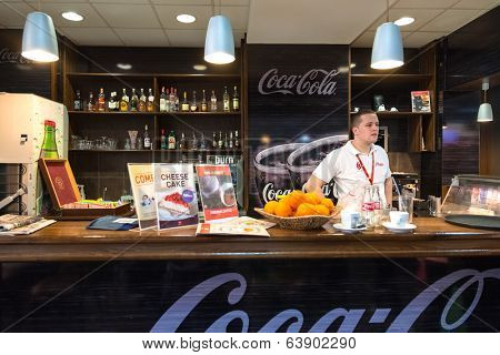 BELGRADE, SERBIA - FEBRUARY 18, 2014: Waiter stands behind bar at Belgrade airport Nikola Tesla,  the fastest growing major airport in Europe.