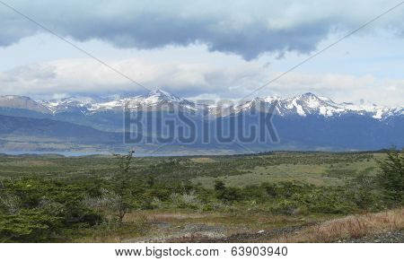 Patagonian Landscape With Lake And Mountains.