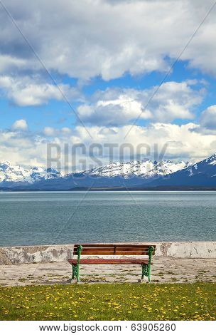 Old Wooden Bench At A Lake With Mountain View