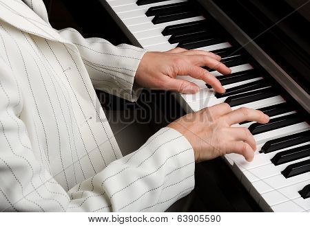 Hands and piano.